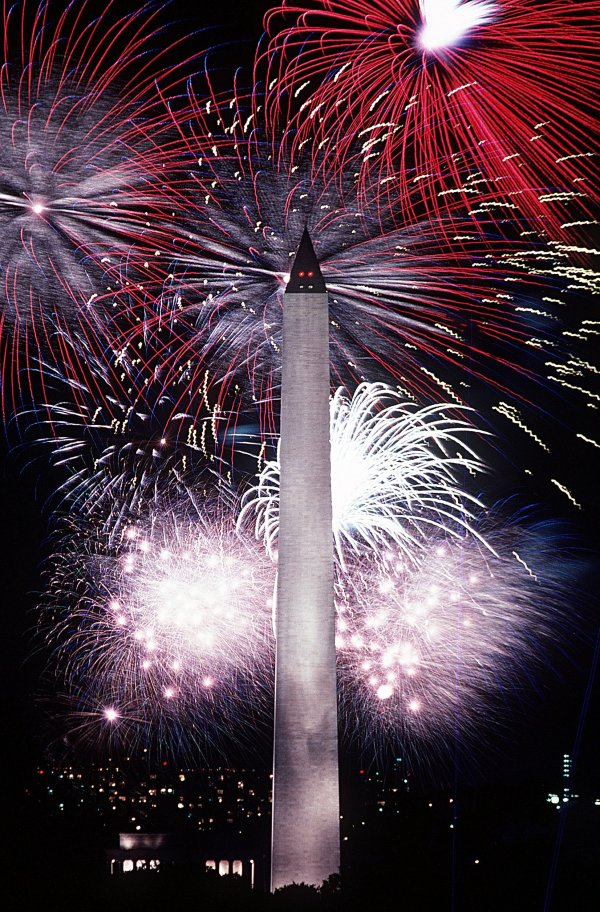 Fireworks behind the Washington Monument, Washington, D. C. image via en.wikipedia.org.
